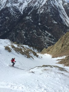 Michael Schilling drops into the 3,200' Northwest Couloir of Peak O Gore Range Colorado